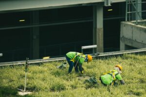two-workers-near-building